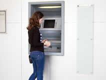 Cash from atm. Woman withdrawing cash from an atm banking machine Stock Image