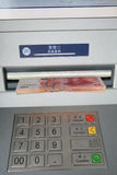 Cash in ATM Stock Image