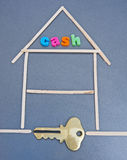 Cash in the attic: raise extra funds. An diagrammatic image of a house with the word ' cash ' in the attic. The letters are colorful bold lower case. A gold key stock photography