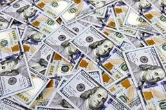 Cash Background of Hundred Dollar Bills. Several Hundred dollar bills make a cash background royalty free stock photography