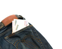 Cash in the backpocket jeans, to travel, isolate on white backgr Stock Photo