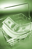 Cash in basket Royalty Free Stock Photos