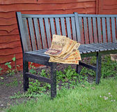 Cash on bench Royalty Free Stock Photo