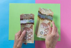 Cash bills from Canadian currency. Dollars. Above view of old re. Tired person paying in cash stock photography