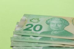 Cash bills from Canadian currency. Dollars. Bills on colorful br. Ight table royalty free stock photo