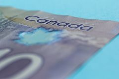 Cash bills from Canadian currency. Dollars. Bills on colorful bright table. Concept of loan, wealth stock image
