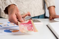 Cash bills from Canadian currency. Dollars. Old woman offering b. Ills on table stock photos
