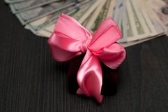 Cash bonus and winnings, a gift for relatives. A gift for relatives Royalty Free Stock Photo