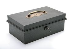 Cash box. An antique cash box with key on a white background Stock Photos