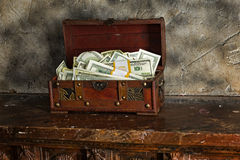 Cash  in a box. Storage of cash at home in a box Stock Photography