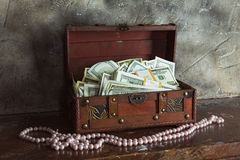 Cash  in a box. Storage of cash at home in a box Royalty Free Stock Photos