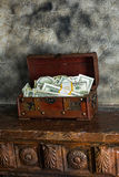 Cash  in a box. Storage of cash at home in a box Royalty Free Stock Photography