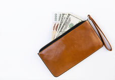 Cash in brown leather purse on white background Royalty Free Stock Images