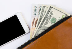 Cash in brown wallet and smartphone Royalty Free Stock Photo