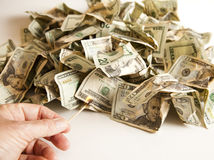 Cash Burn. Setting fire to a pile of money Stock Image