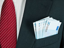 Cash in business suit pocket - Euro Stock Images