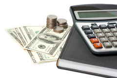 Cash, calculator and pen isolated Stock Photography