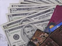 Cash or card. American dollars with wallet and credit cards stock image