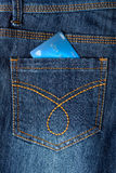 Cash card in jeans back pocket Royalty Free Stock Photos