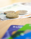 Cash & Cards. With Depth of Field Effect. Focus on Pound Coin stock photo