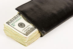 Cash in Checkbook. A checkbook is stuffed with one hundred dollar bills Stock Photography