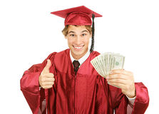 Cash for College. Excited graduate holding a fist full of cash for college and giving a thumbs-up sign.  Isolated on white Stock Photography