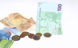 Cash or credit. Euro notes and coins and credit card on white background Royalty Free Stock Images