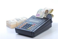 Cash on credit card machine Stock Image