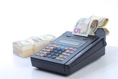 Cash on credit card machine Stock Image