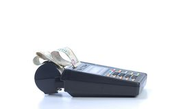 Cash on credit card machine Royalty Free Stock Images