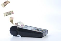 Cash on credit card machine Stock Images