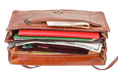 Cash, credit cards, documents in female handbag Royalty Free Stock Photos