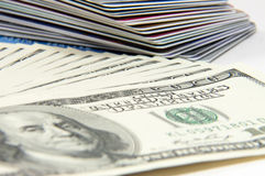 Cash and credit. A stack of credit cards and cash Stock Images