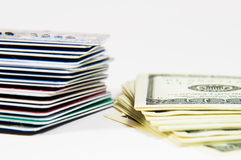 Cash or credit. A stack of cash and credit cards on a white background Royalty Free Stock Photo