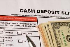 Cash deposit slip. Personal banking deposit slip with bank notes royalty free stock image