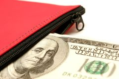 Cash deposit on white. Macro of american currency and inside a red bank deposit bag stock image