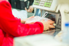 Cash-desk with cashier and terminal in shop Royalty Free Stock Image
