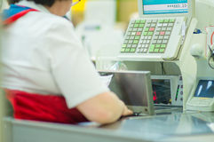Cash-desk with cashier and terminal in shop Stock Photo