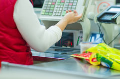 Cash-desk with cashier and terminal in shop Royalty Free Stock Photography