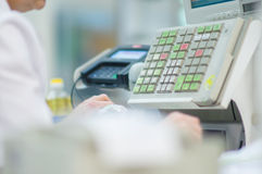 Cash-desk with cashier and terminal in supermarket Royalty Free Stock Photo