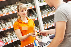Cash desk female worker accept payment card at hardware shop Stock Photos