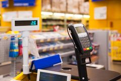 Cash desk with payment terminal in supermarket Stock Image