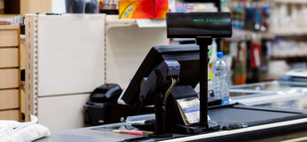 Cash desk with terminal in supermarket Royalty Free Stock Photos