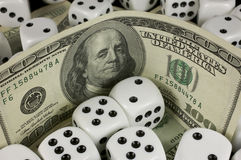 Cash and dice Royalty Free Stock Images