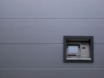 Cash dispenser. And metal wall Stock Images