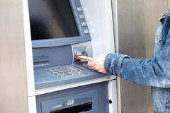 Cash dispenser. Take cash from the ATM Royalty Free Stock Photography