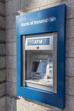 Cash dispenser of the Bank of Ireland, 2015. ATM with display and keypad in Dublin Royalty Free Stock Images