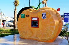 Cash dispenser in Bodrum ,Turkey. Cash dispenser in the form of orange in Bodrum ,Turkey stock photography