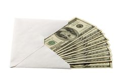 Cash in the envelope. Isolated over white Royalty Free Stock Photo