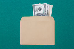 Cash in an envelope. On a green background Royalty Free Stock Photo